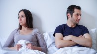 Sad couple and relationship difficulties in bed