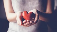 woman holding red heart, health insurance, donation charity concept