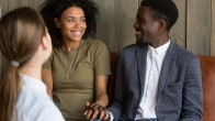 Happy African American couple reconciled after successful psychological treatment