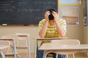 Frustrated Teenage Boy in Classroom
