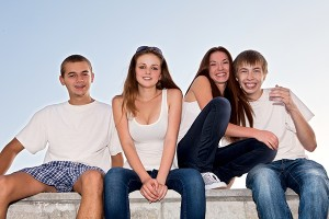 happy-teens-4-kids-students-college-shutterstock_83588497